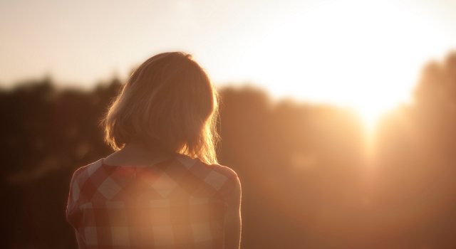 Image of a woman in the sun
