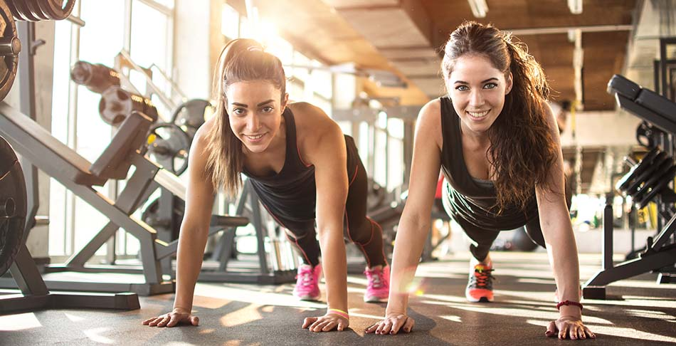Image of two women exercising